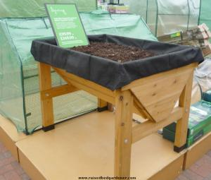 High level wooden raised bed